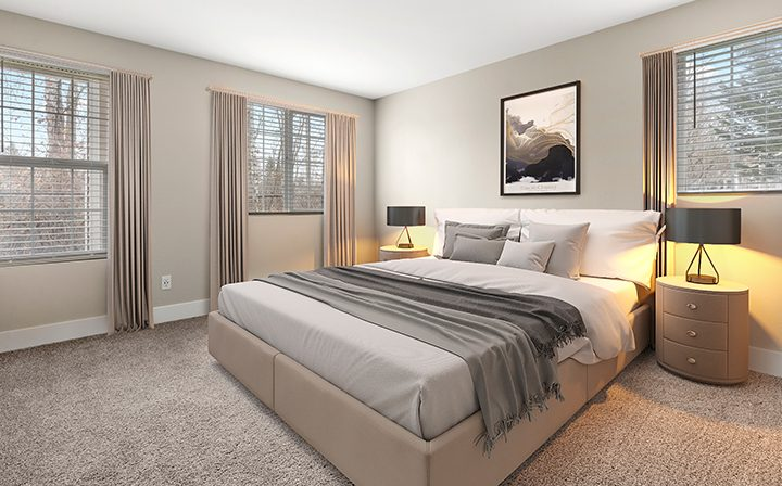 Furnished bedroom in a model unit at the Kent apartments community Indigo Springs
