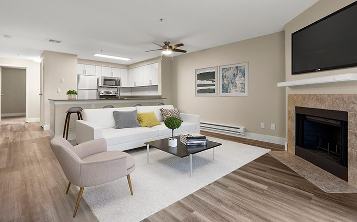 Furnished living room in a model unit at the Kent apartments community Indigo Springs