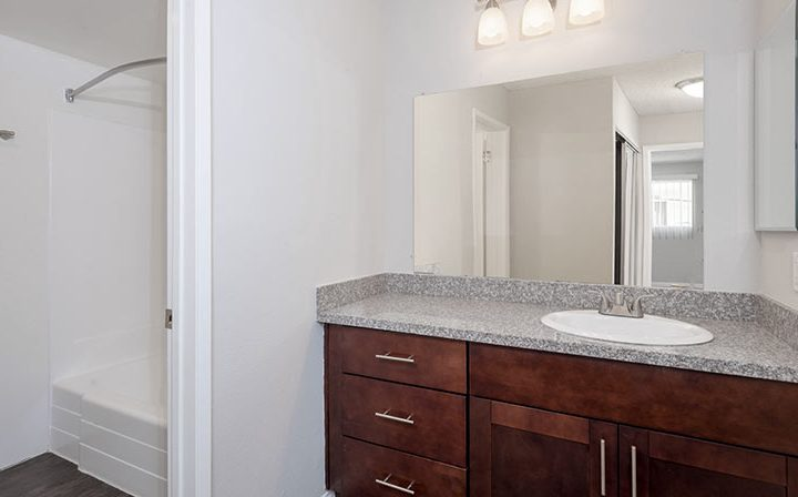 Unfurnished bathroom with brown cabinets at the Los Angeles apartments community Kaitlin Court
