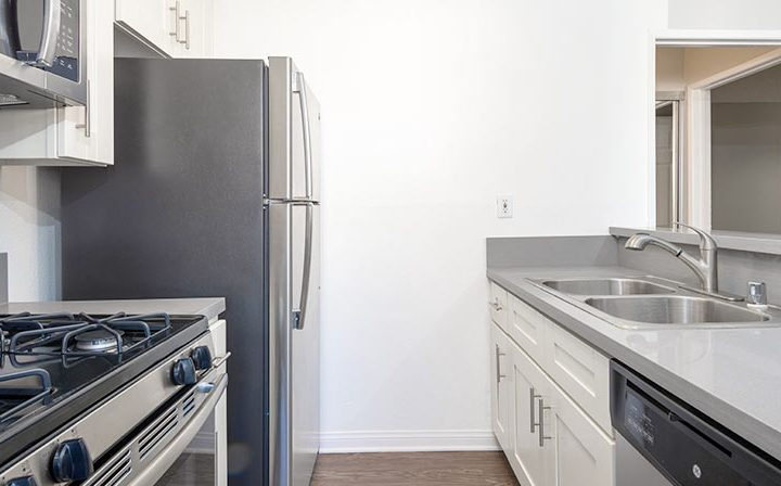 Kitchen with range and fridge adjacent to stove at Kaitlin Court, apartments in Los Angeles