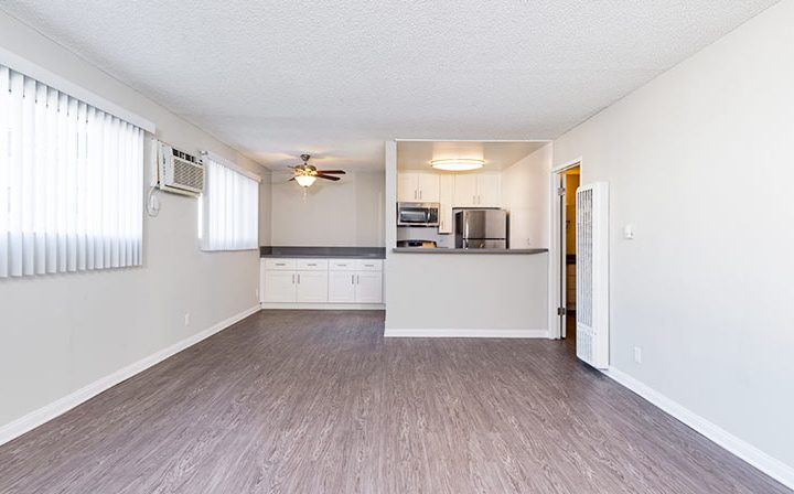 Well-lit living room with wood floors at the Los Angeles apartments community Kaitlin Court