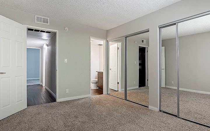 Unfurnished bedroom facing bathroom and hallway at Kaitlin Court, apartments in Los Angeles