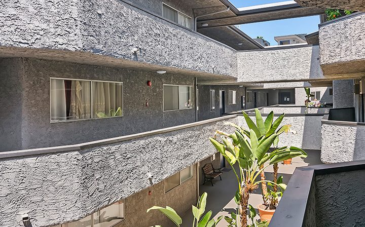 View of the courtyard from the second-floor walkway at Kaitlin Court, apartments in Los Angeles