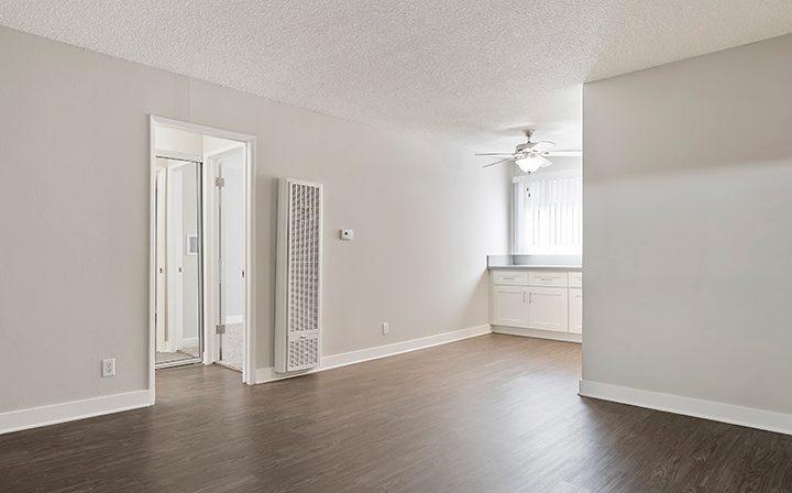 Bathroom/bedroom hallway with wood flooring at Kaitlin Court, apartments in Los Angeles