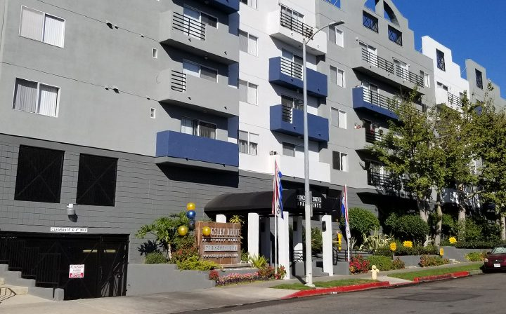 Angled streetside view of Koreatown apartments community Kingsley Drive exterior in Los Angeles
