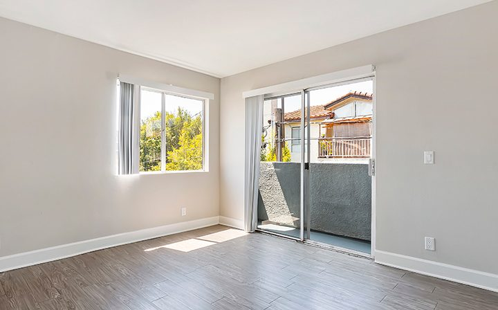 Unfurnished bedroom with balcony at Kingsley Drive, apartments in Koreatown, Los Angeles