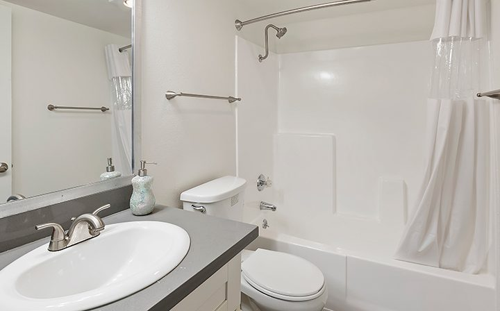 Shower/tub combo in unfurnished bathroom at Kingsley Drive, apartments in Koreatown, Los Angeles