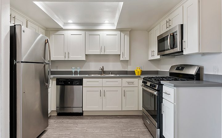 Kitchen with artificial skylight at the Koreatown apartments community Kingsley Drive in Los Angeles