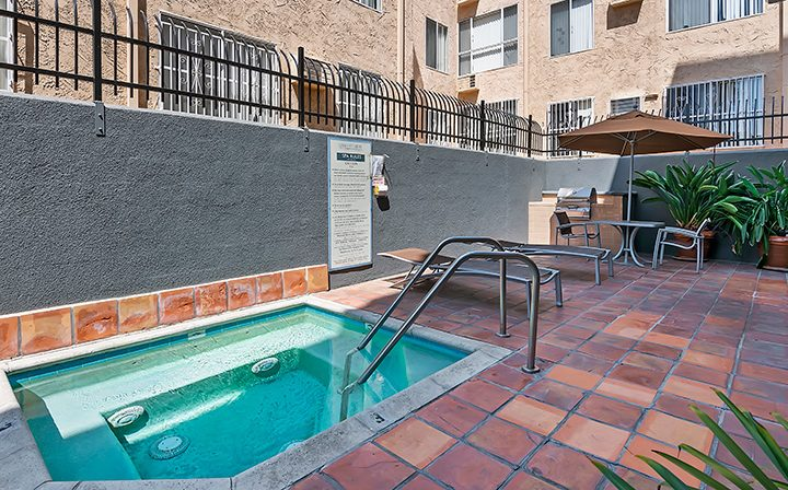 Outdoor spa near pool during the day at Kingsley Drive, apartments in Koreatown, Los Angeles