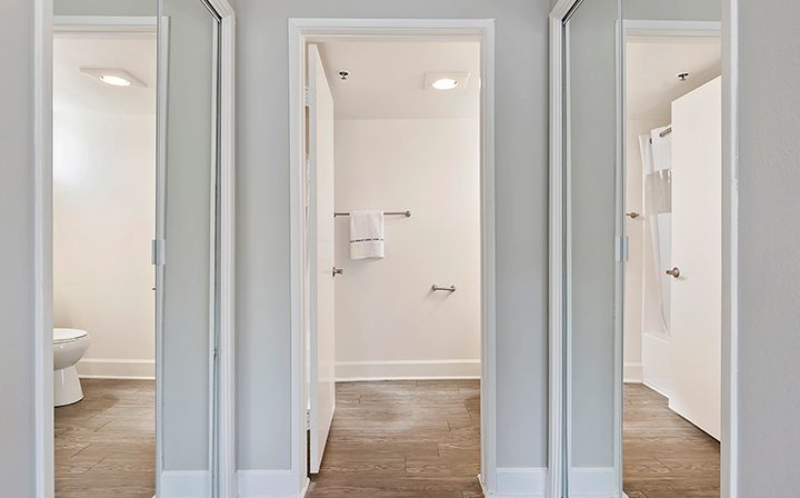 Mirrored hallway by bathroom at the Koreatown apartments community Kingsley Drive in Los Angeles