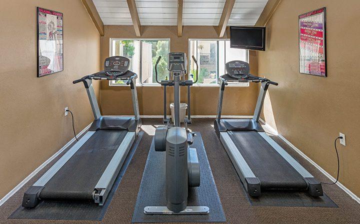 Treadmills in front of windows at Los Feliz Village, Awater Village apartments in Los Angeles