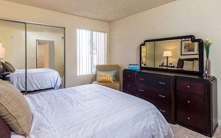 Bedroom with mirrored closet at Los Feliz Village, Awater Village apartments in Los Angeles