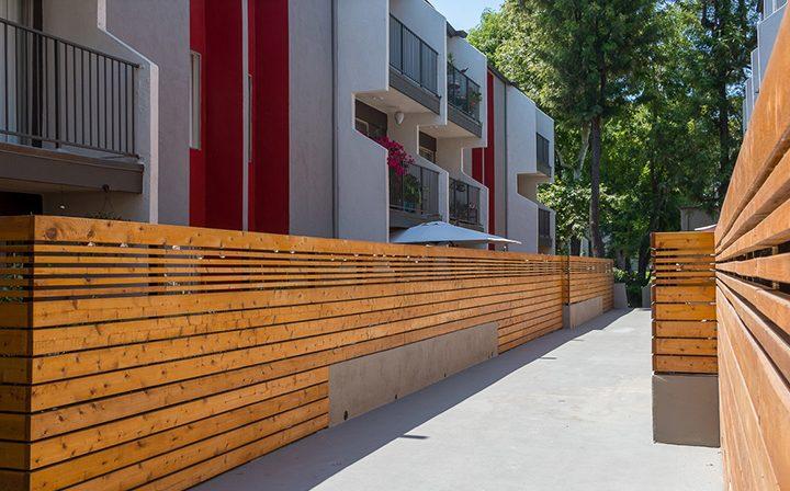 Outdoor path with units adjacent at Los Feliz Village, Awater Village apartments in Los Angeles