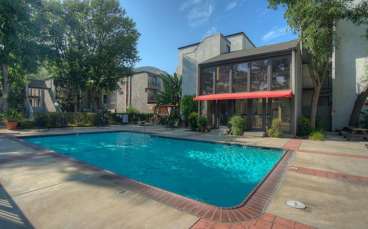 Shaded outdoor pool at the Atwater Village apartments community Los Feliz Village in Los Angeles