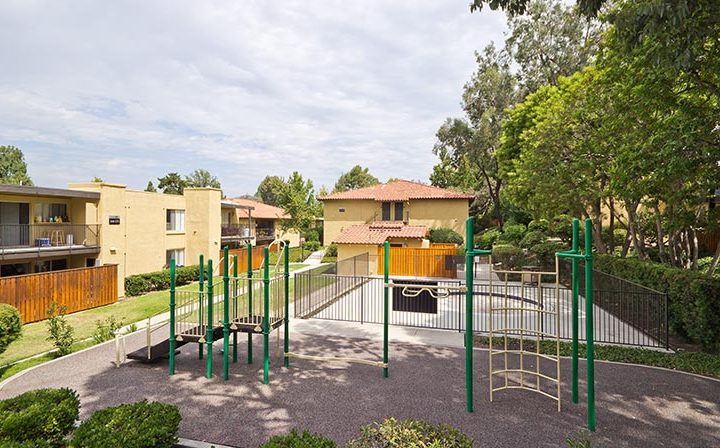 Simple children's playground next to units at the Thousand Oaks apartments community Los Robles