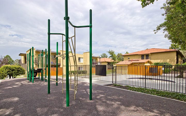Children's playground on gravel next to spa at Los Robles, apartments in Thousand Oaks