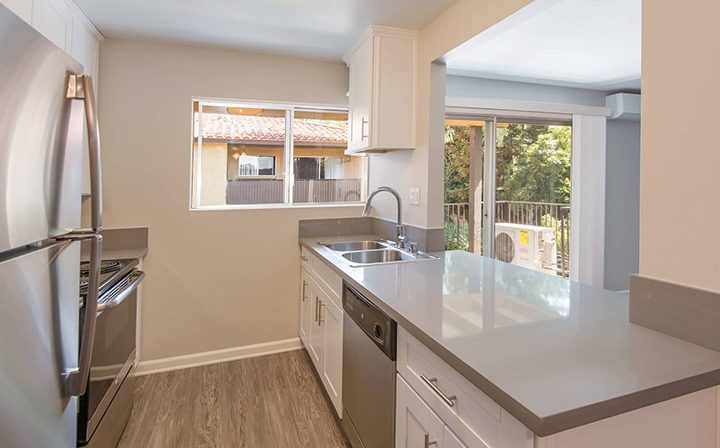 Sunny, unfurnished kitchen with sink opposite range at Los Robles, apartments in Thousand Oaks