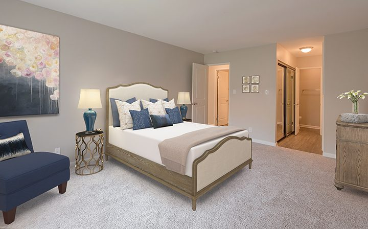 Render of furnished bedroom with art at the Thousand Oaks apartments community Los Robles