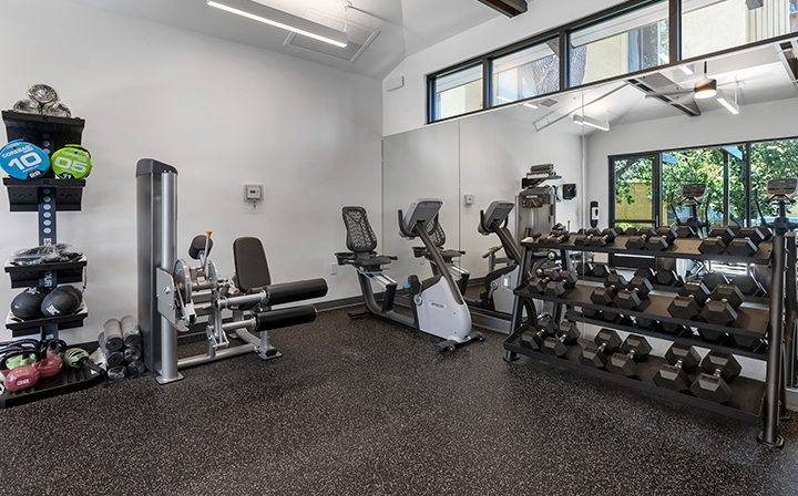 Free weights in the fitness center at the Thousand Oaks apartments community Los Robles