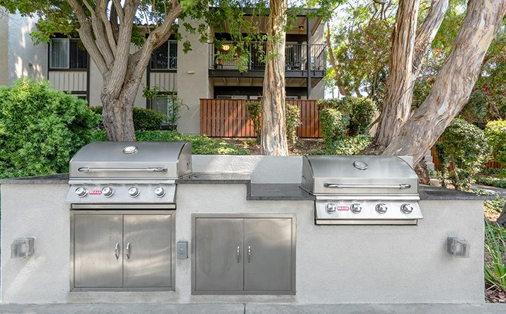 BBQ grills in shade in front of units at Los Robles, apartments in Thousand Oaks