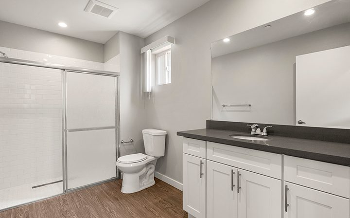 Bright unfurnished bathroom in studio unit at the Thousand Oaks apartments community Los Robles