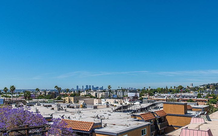 Skyline view of city on clear day at Marlon Manor, Los Angeles apartments in Hollywood