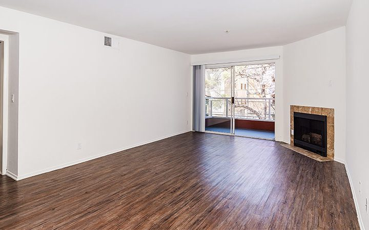 Unfurnished living room with wood flooring at Marlon Manor, Hollywood apartments in Los Angeles