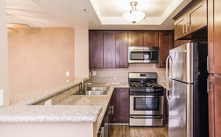 Unfurnished kitchen with brown cabinets at Marlon Manor, Hollywood apartments in Los Angeles