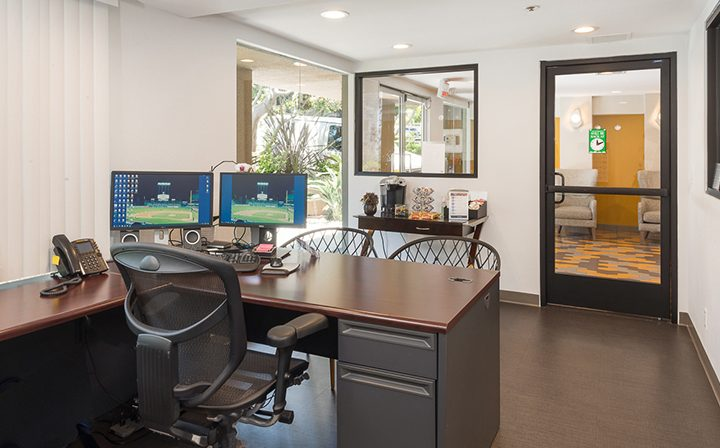 Leasing office desk with computers at Marlon Manor, Hollywood apartments in Los Angeles