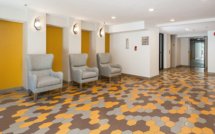 Lobby with comfortable chairs and tiled floor at Marlon Manor, Hollywood apartments in Los Angeles