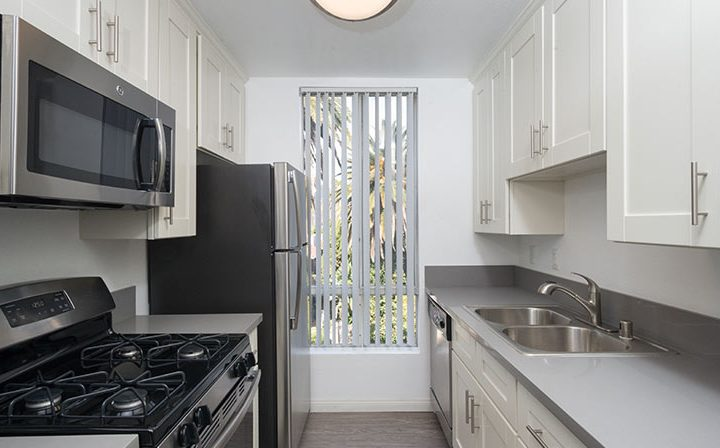 Unfurnished kitchen with tall window at Media Towers, Los Angeles apartments in Hollywood