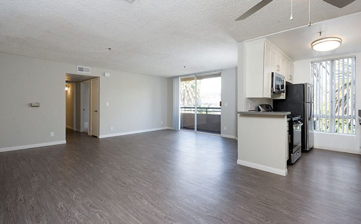 Large unfurnished living room and kitchen at Media Towers, Hollywood apartments in Los Angeles