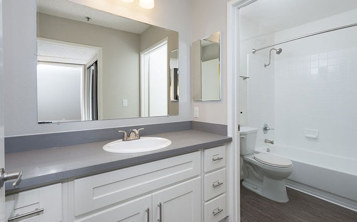 Unfurnished bathroom with white cabinets at Media Towers, Los Angeles apartments in Hollywood