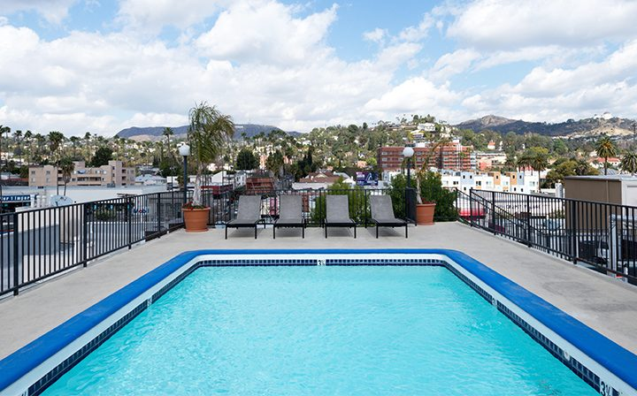 Rooftop pool with seating and stunning view at Media Towers, Los Angeles apartments in Hollywood