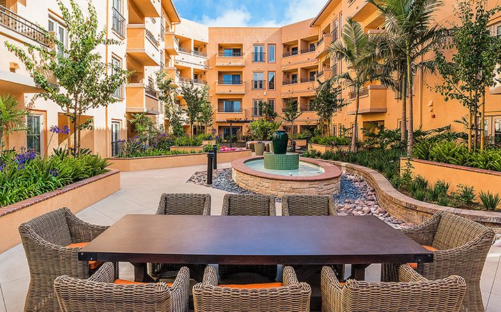 Outdoor picnic table, seating, and fountain at Silicon Beach apartment community Playa del Rey