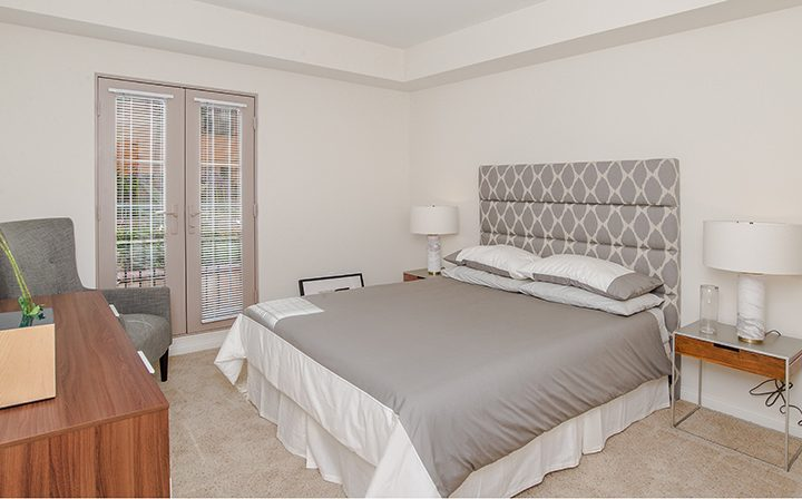 Spacious furnished Silicon Beach apartment Playa del Rey bedroom with exit to large patio
