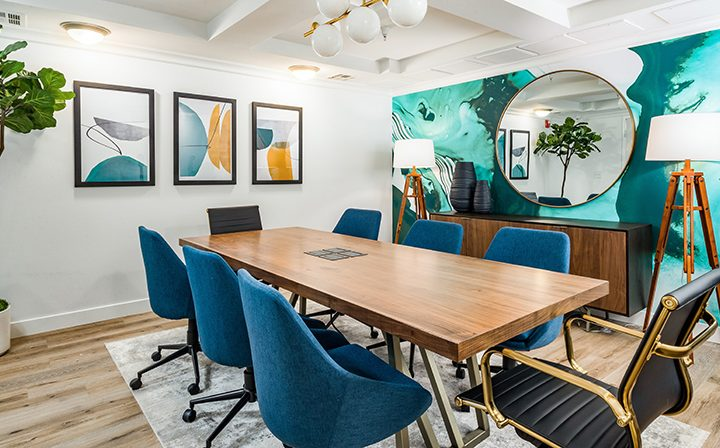 Colorfully decorated meeting room with long table at Silicon Beach apartments Playa del Oro
