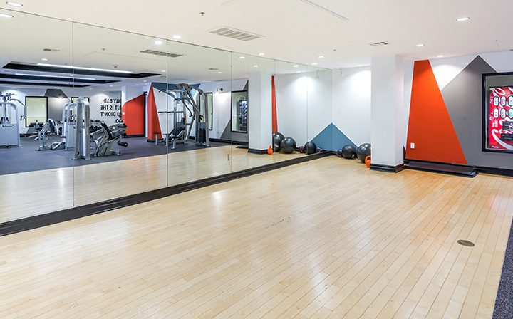Mirrored wall by yoga and stretching area in Silicon Beach apartments community Playa del Rey's gym