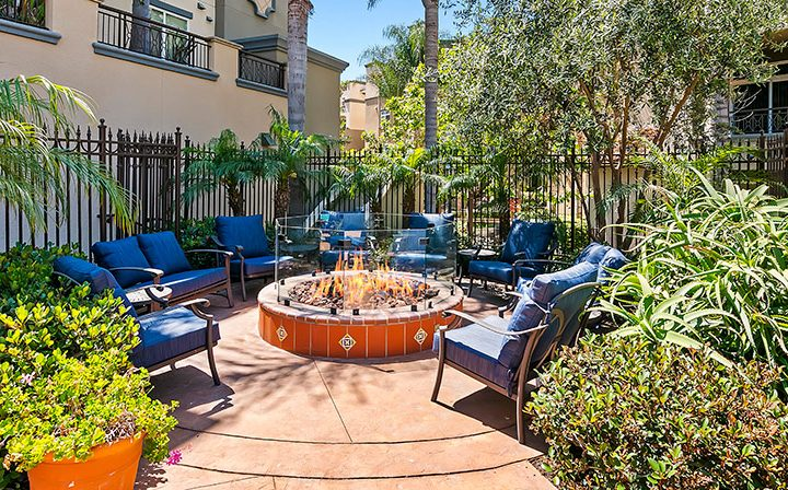 Firepit with seating at the Playa del Rey apartments community Playa del Oro