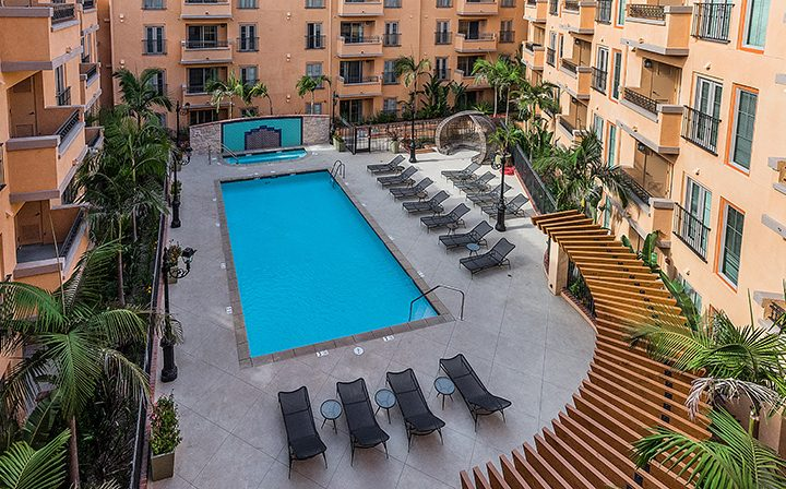 Aerial view of resort style pool at Playa del Rey apartment community Playa del Oro