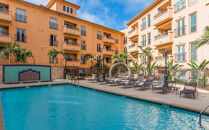 Large resort style pool at Playa del Rey apartment community Playa del Oro