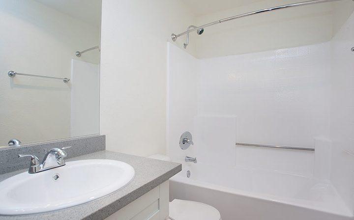 White bathroom with shower/bathtub combo at Playa Marina, Playa Vista apartments in Los Angeles