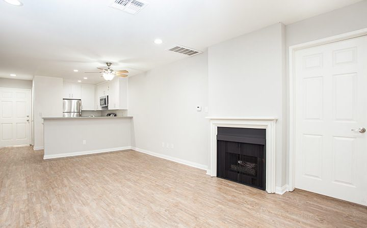Living room with fireplace and wood floor at Playa Marina, Playa Vista apartments in Los Angeles