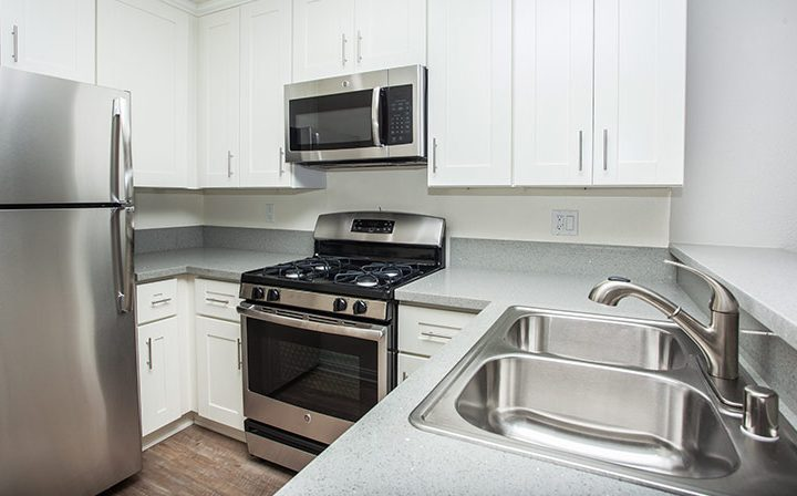 Corner kitchen with white cabinets at Playa Marina, Los Angeles apartments in Playa Vista