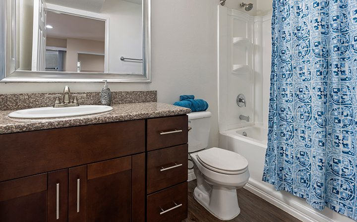 Furnished bathroom with brown cabinets at Playa Marina, Los Angeles apartments in Playa Vista