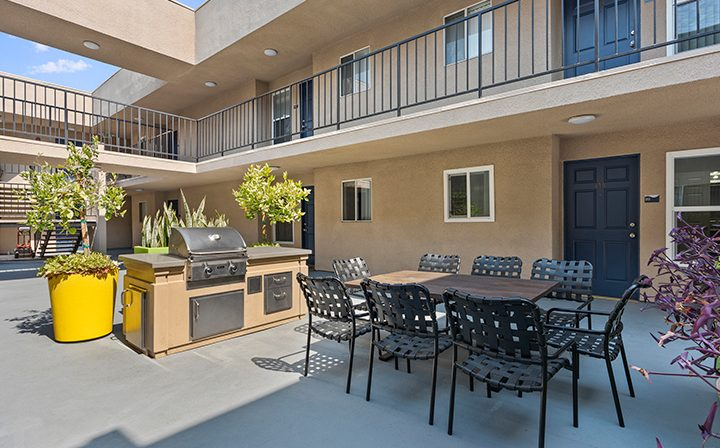 BBQ grill next to seating in courtyard at Playa Marina, Los Angeles apartments in Playa Vista