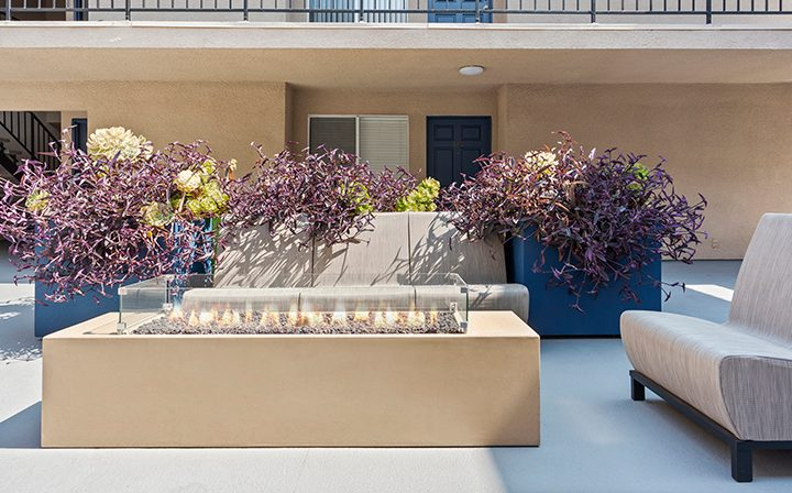 Covered firepit next to seating and planters at Playa Marina, Playa Vista apartments in Los Angeles