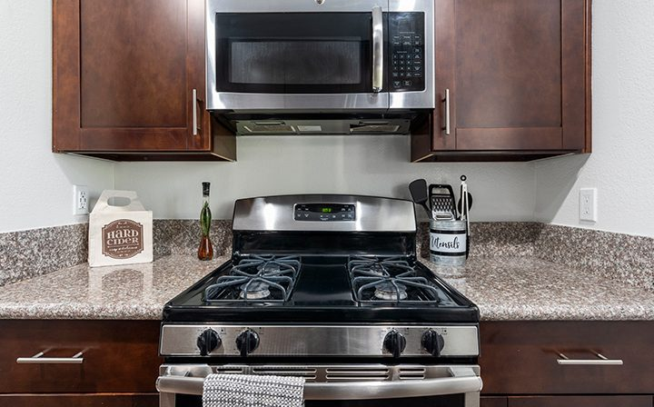 Furnished kitchen with microwave above stove at Playa Marina, Playa Vista apartments in Los Angeles