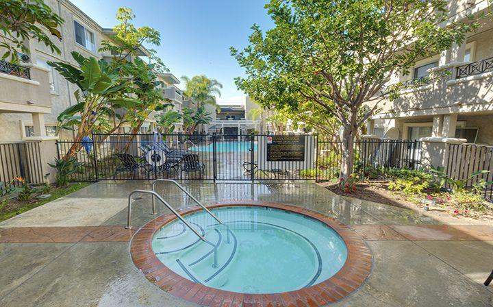 Circular hot tub spa near pool at Playa Pacifica, Playa del Rey apartments in Los Angeles
