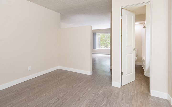 Sunny, unfurnished apartment hallway at Playa Pacifica, Playa del Rey apartments in Los Angeles